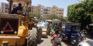 جهاز مدينة العبور ينفذ حملة جديدة لإزالة الإشغالات ويكثف أعمال تطوير الطرق والميادين بالمدينة